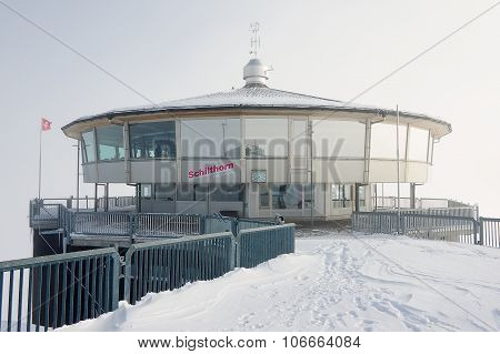 Exterior of the Piz Gloria revolving restaurant on a winter cloudy day circa Murren, Switzerland.