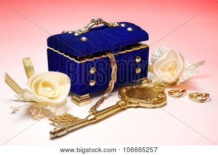 Treasure. Golden Key, Wedding Rings And White Roses