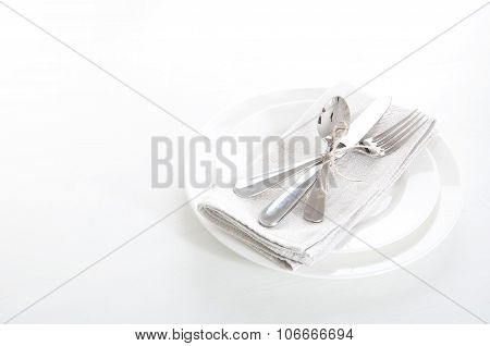 Table Setting In White And Gray Colors