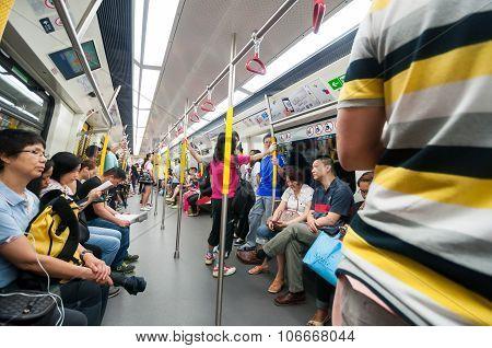 Passengers On The Hong Kong Mtr.