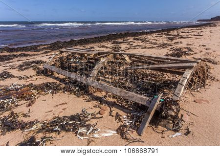 broken lobster trap on beach, Prince Edward Island