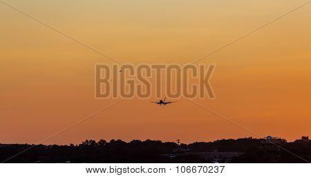 Planes Landing At Dusk