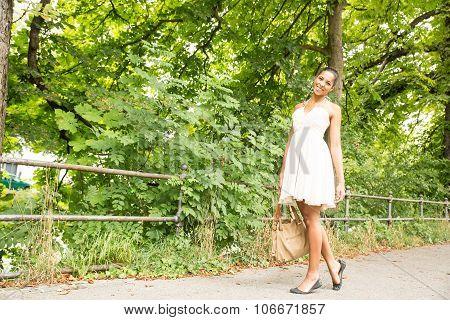 Young Girl Walking In The Park.