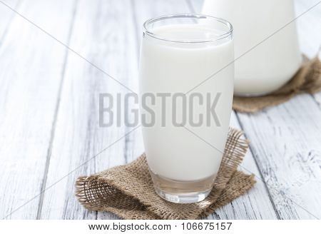 Milk On Bright Wooden Background