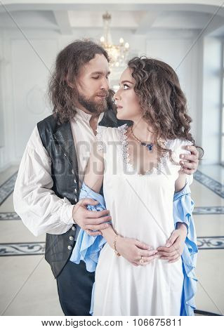 Handsome Man In Medieval Costume Undress Beautiful Woman