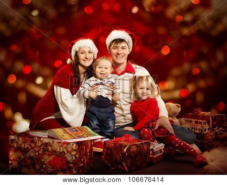 Christmas Family Four Persons over Red Background