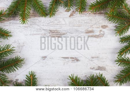 Framework Of Spruce Branches For Christmas On Old Wooden Plank