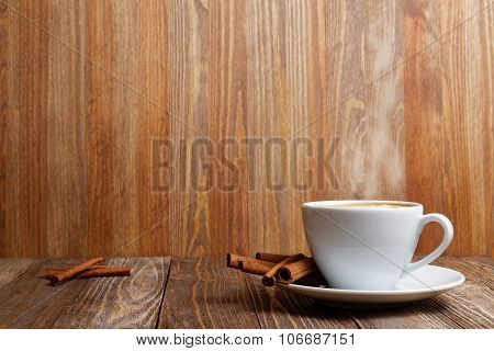 Steaming Cup Of Hot Cappuccino And Cinnamon