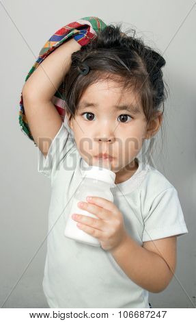 Asian Girl Addict Her Textile And Milk Bottle
