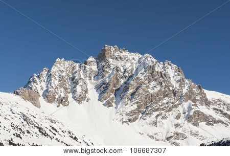 Rocky Alpine Mountainside In Winter
