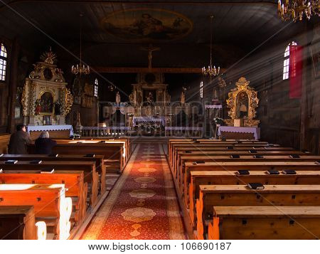 Koszecin, Poland 01 November 2015 .: Rays Of The Sun Illuminate The Old, Dark Wooden Church Of The H