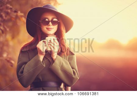 Young Girl With Cup