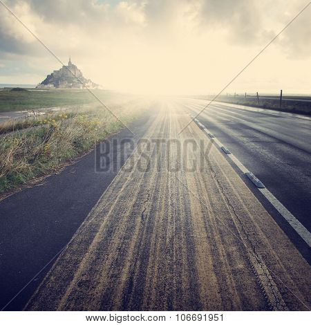 Vintage image of road to Mont Saint Michel, Normandy. France.