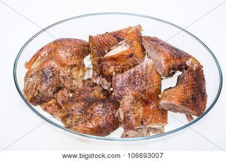 pieces of the roasted goose isolated on white