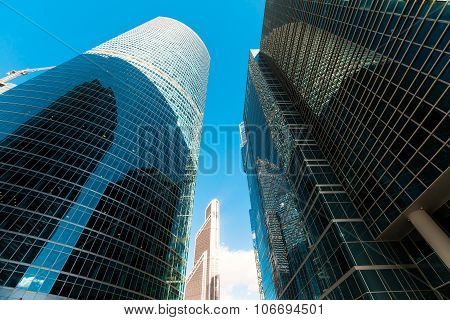 Blue skyscraper facade. office buildings. modern glass silhouett