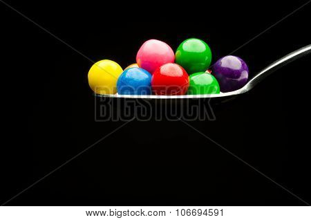Gumballs on a spoon