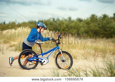 Cute little boy face on bike