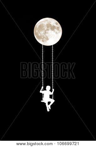 boy on a swing at moonlight