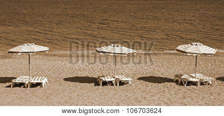 Greece. Kos Island. Kefalos Beach. Chairs And Umbrellas. In Sepia Toned. Retro Style