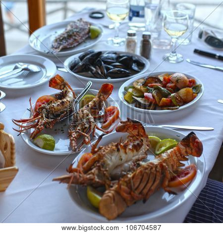 Lobster And Vegetables An The Table In Typical Greek Taverna, Crete, Greece