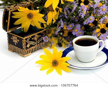 The Open Casket Decorated Yellow With Flowers And Coffee, Isolate
