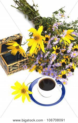 The Open Casket Decorated With A Bouquet Of Yellow Flowers And Coffee The Top View
