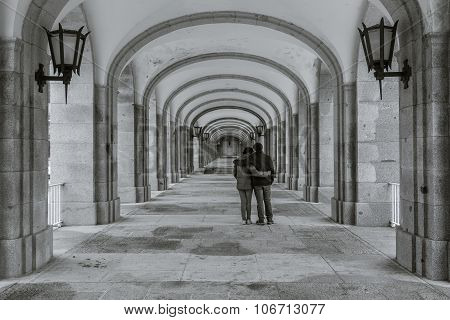 A Couple In The Symmetrical Corridor