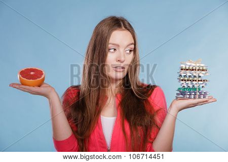 Woman With Diet Weight Loss Pills And Grapefruit.