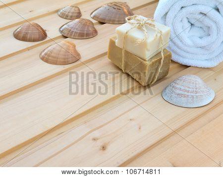 White Towel, Seashells And Soap Bars