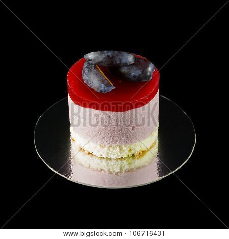 One small cake decorated with plum wedges
