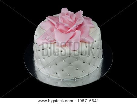 One white cake decorated with a pink rose