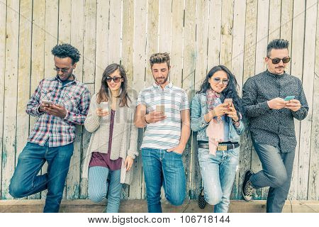 Friends Texting With Smartphones