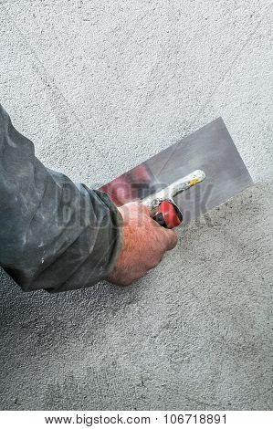 Construction Worker Smoothing - Plastering Concrete Wall By A Steel Trowel - Spatula Aligns