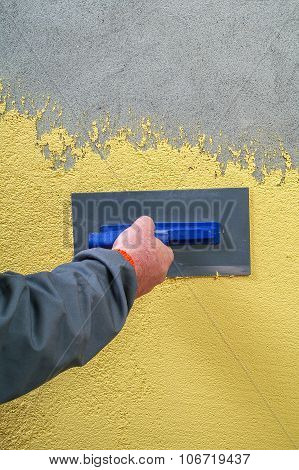 Construction Workers Applied Decorative Plaster Facades On The Concrete Wall By A Steel Trowel - Pla