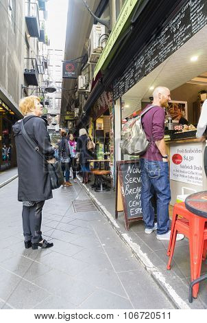 Customers outside a cafe in Melbourne