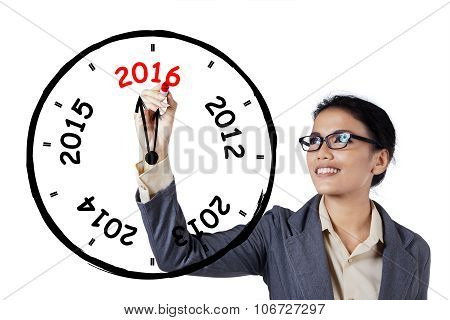 Businesswoman Drawing An Annual Clock