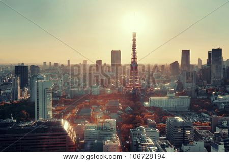 Tokyo Tower and urban skyline rooftop view at sunset, Japan.
