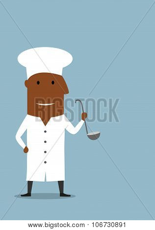 Chef or cook in white uniform with ladle
