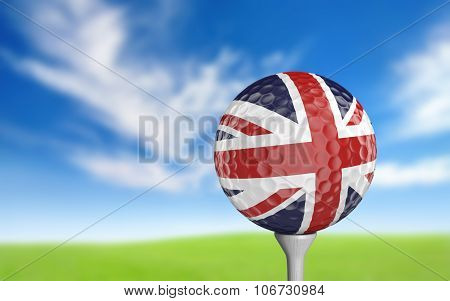 Golf ball with United Kingdom flag colors sitting on a tee