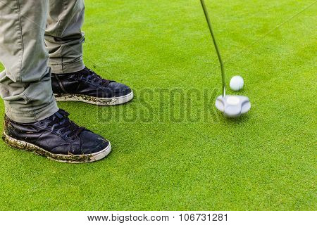 Hitting A Golf Ball With A Putter