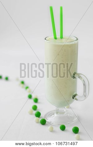 milk yogurt smoothie cocktail green and white candy drop