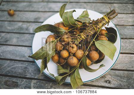 Asian fruit Longan - on wood background