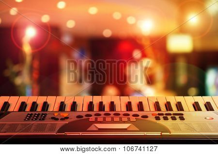 Music synthesizer on a background of colored light