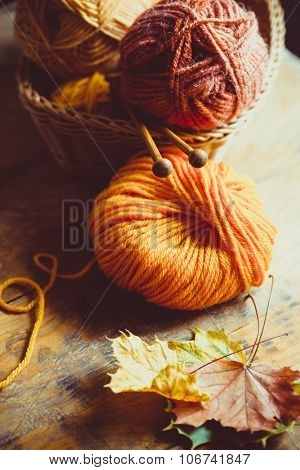 Autumn Knitting, knitting needles and yarn in autumn colors