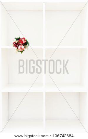 Christmas Decoration On Vertical White Bookshelf