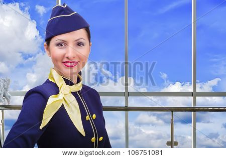 Portrait of smiling stewardess at the airport