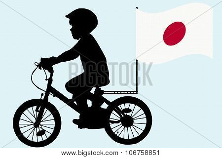 A Kid Rides A Bicycle With Japan Flag