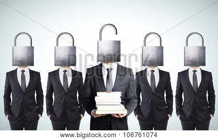Businessman With Pack Of Book And Businessmen With Closed Head Locks