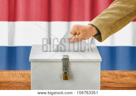 Man Putting A Ballot Into A Voting Box - Netherlands