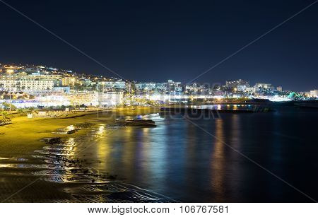 Night View Of The City And The Sea